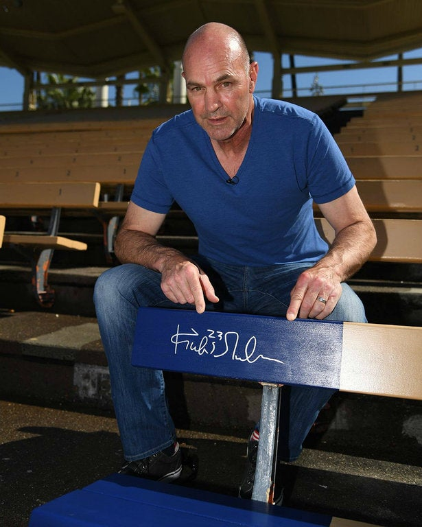 Kirk Gibson and his commemorative Home Run Seat at Dodger Stadium